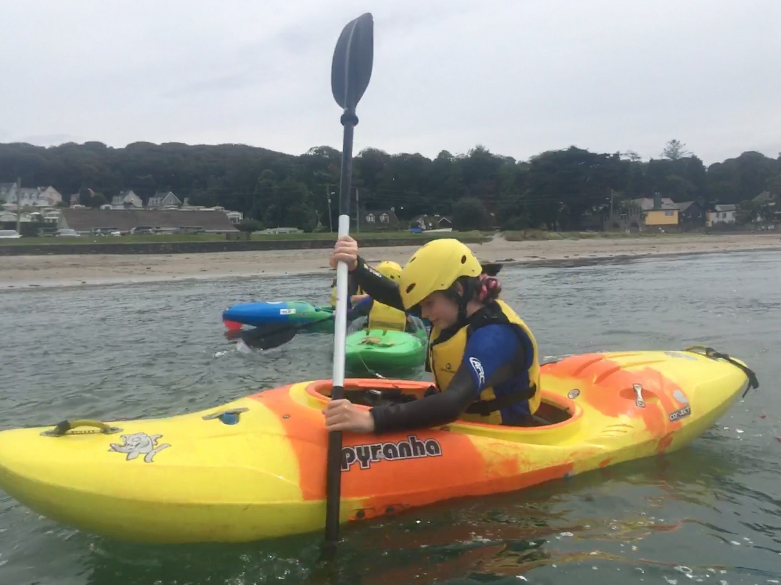 girl learning to kayak in cork