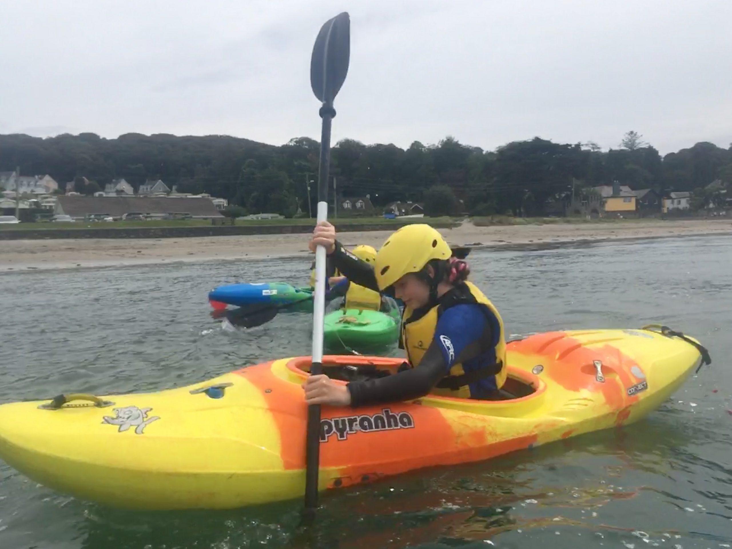 girl learning to kayak in cork