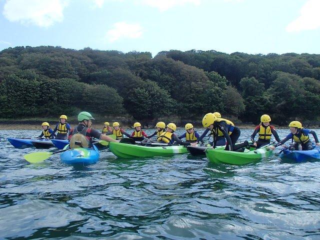 kids kayaking on the sea, watersports in cork